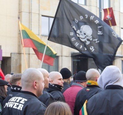 white power symbol and swastika in neo-Nazi march in central Vilnius March 11th 2013
